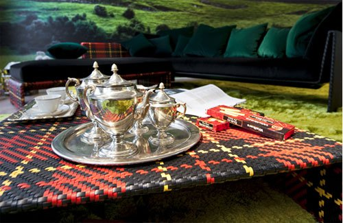 Black and red tartan small picnic table, with silver tea service on top