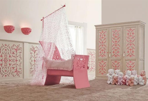 Luxury cream and pink nursery, with white voile canopy over a pink cot