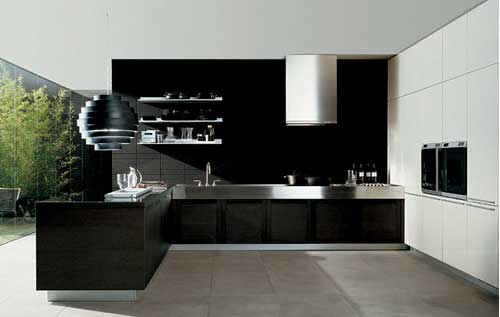 Black and white kitchen with floor to ceiling windows looking out into the garden