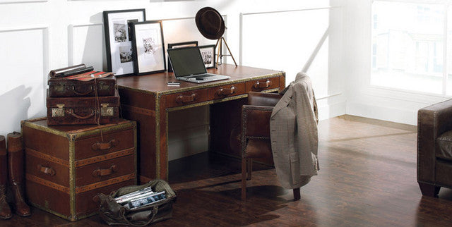 Modern home office with traditional suitcase themed desk and furniture