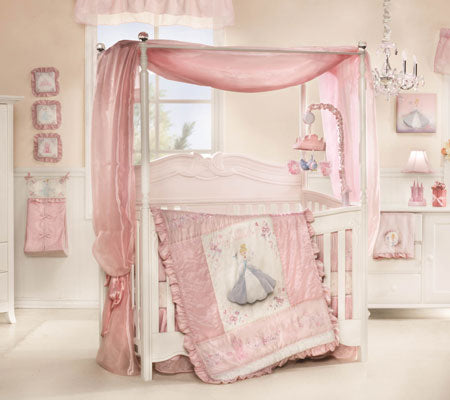 Cream and pink nursery with cream cot and pink canopy