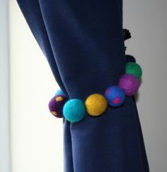 Curtain tieback made from coloured felt balls