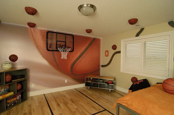 Basketball themed wall decal with real basket ball halves glued to the wall