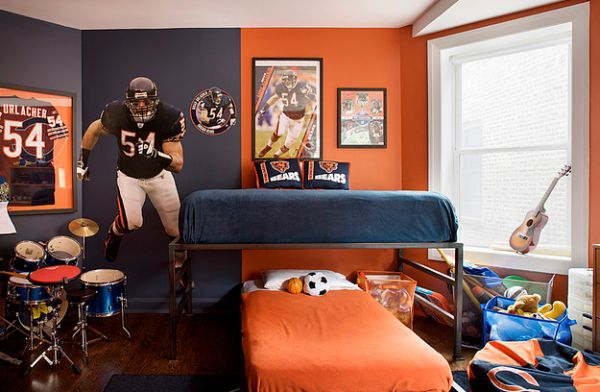 NFL bedroom in blue and orange with wall decals and frames team shirt