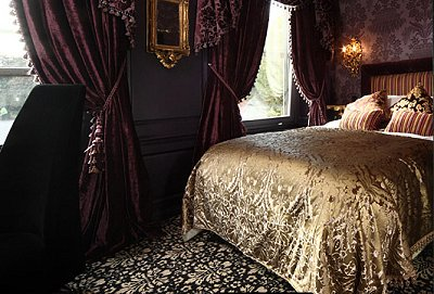 Victorian Gothic bedroom in burgundy and gold