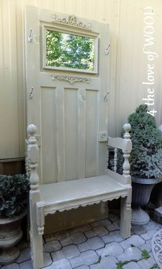 Stylish thrown like chair made from an up-cycled cream door, with mirror where glass panel used to be