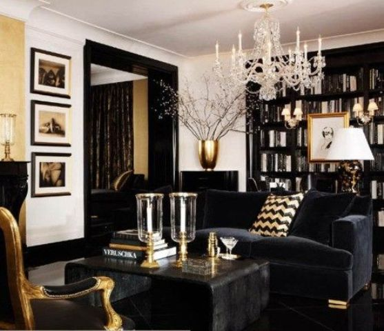 Black and white living space with white walls, black sofa and black bookcase