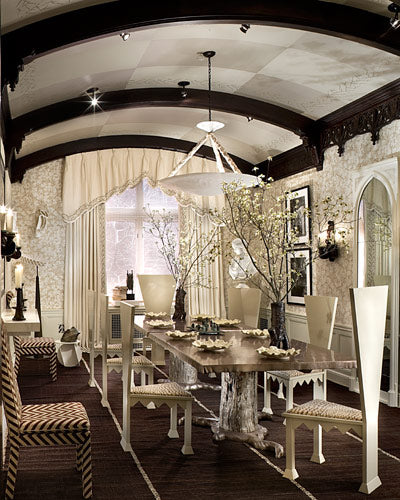 Long Gothic dining room in white, with curved ceiling and black curved ceiling beams