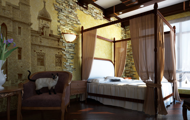 Beige and yellow bedroom with four poster bed, and wall decal of a castle photograph