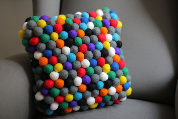 Scatter cushion made from coloured felt balls