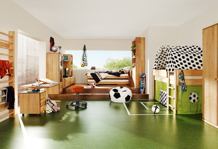 Green laminate floor with football pitch markings and football accessories and balls