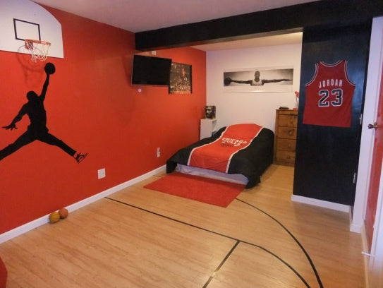 Basketball bedroom with hoop and net, and framed Michael Jordan shirt