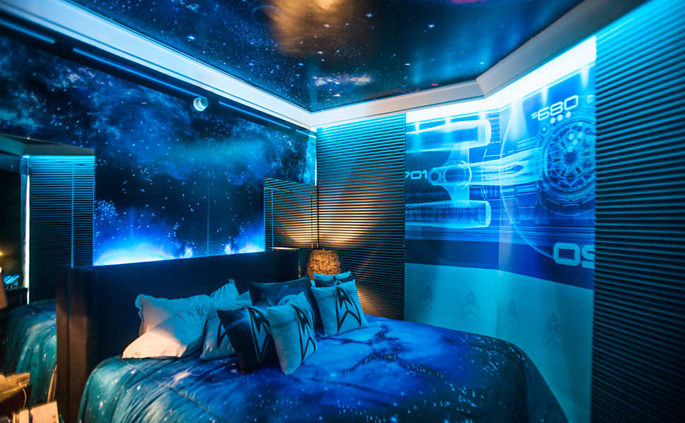 Blue Lit Bedroom With Blueprint Of Star Trek Spaceship On The Wall