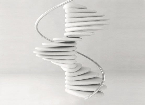 wonderful-white-spiral-staircsae-it-seems-lik-it-consists-of-pebbles-staircase-designs-innovative-spiral-staircase-designs-as-your-new-stairs-ideas