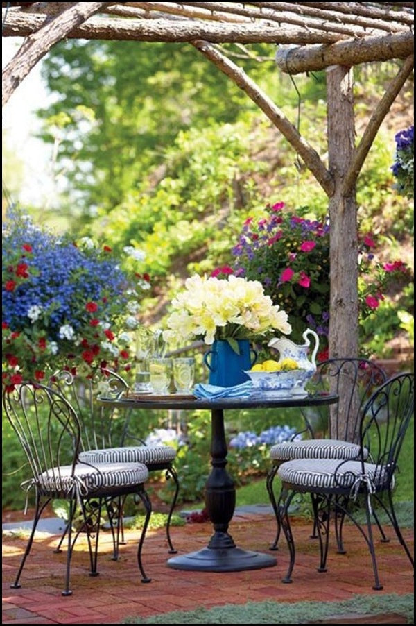 Wooden tree trunk and branch garden veranda and glass breakfast table