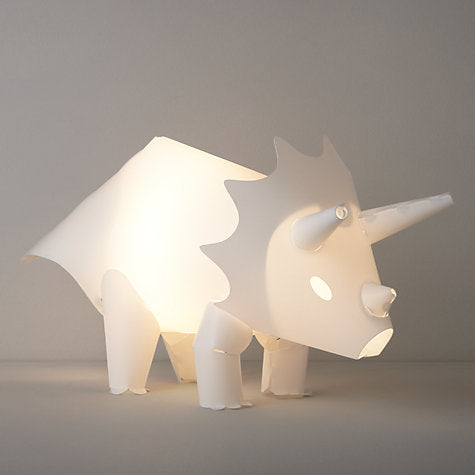 A white hollow plastic triceratops with white light inside