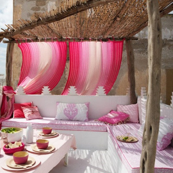 Bamboo and driftwood canopy, with pink fabrics and accessories