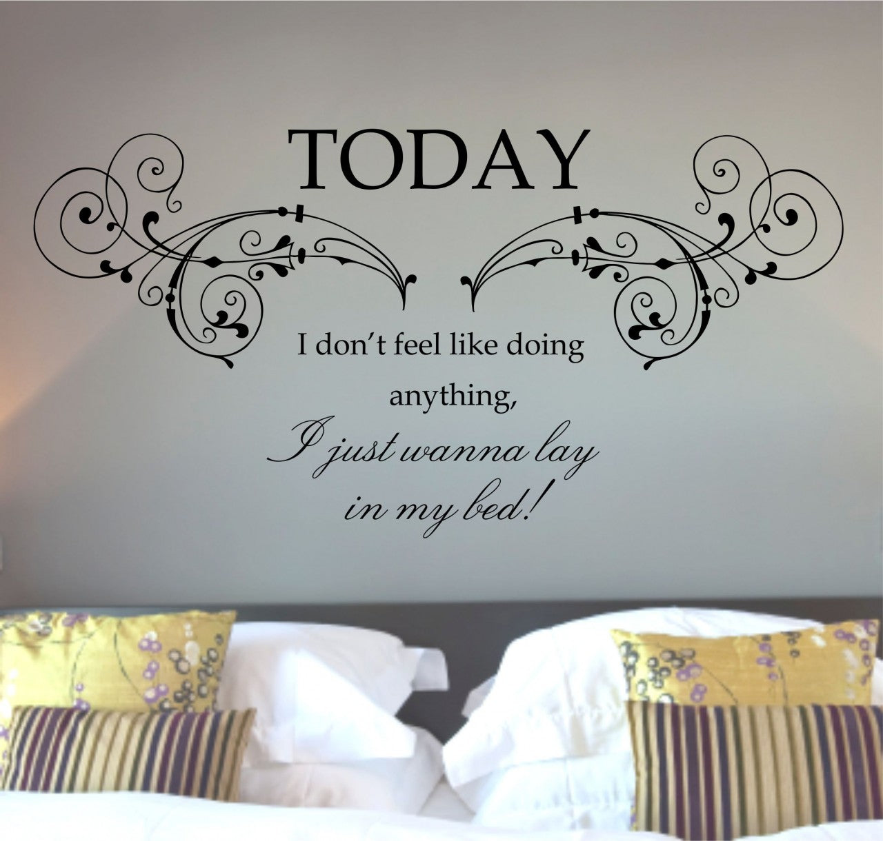 A wall decal in text saying I just wanna lay in my bed