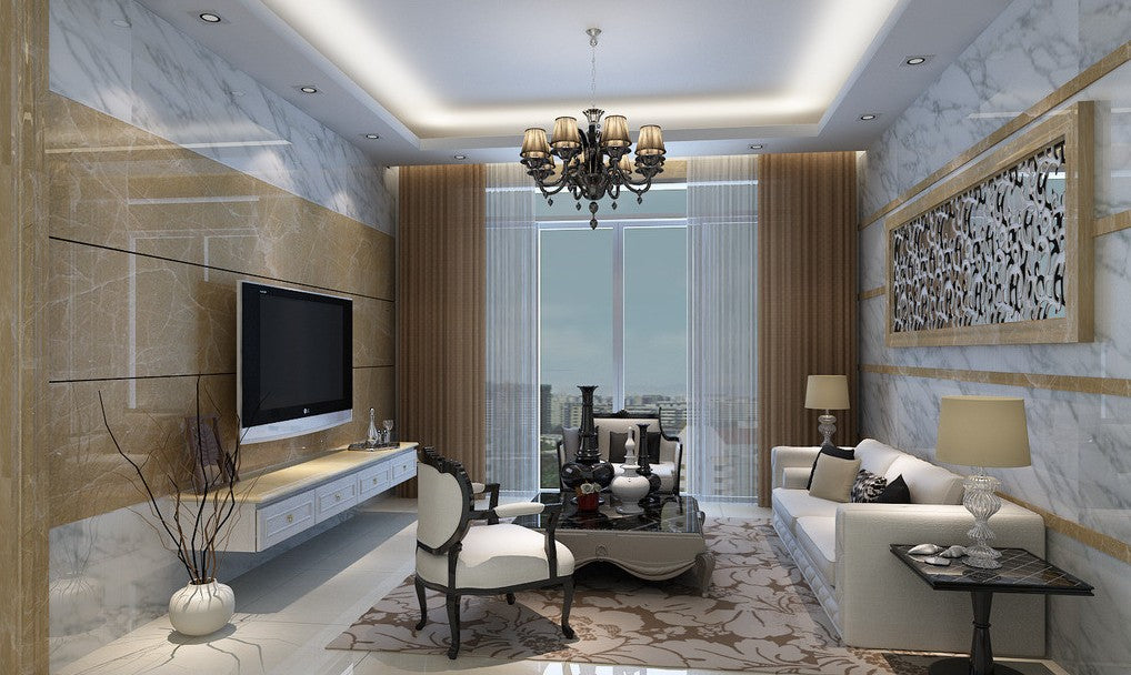 Beige and grey marble walls in a living room, with cream sofa and wall mounted TV