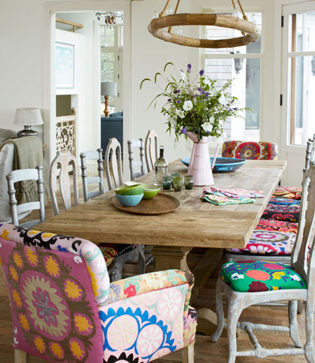 Mismatched chairs around a solid wood table