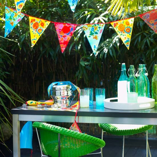 Alfresco dining area with brightly coloured bunting