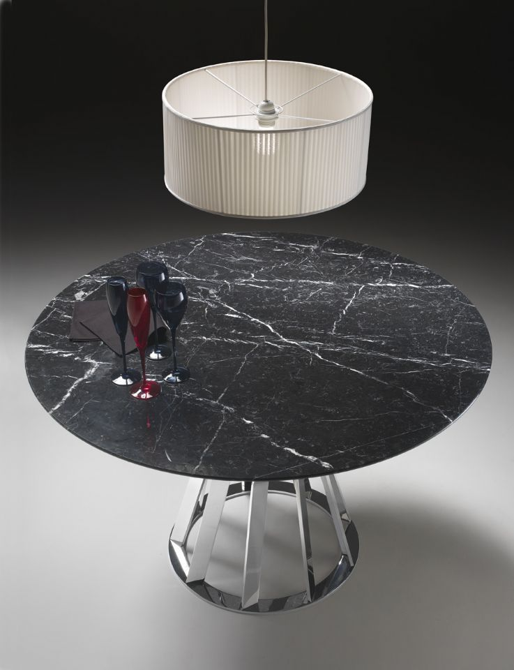 Round marble table with a low round lampshade suspended above it