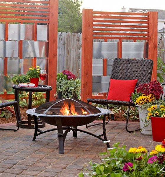 Wooden privacy screens in a cosy garden, with fire pit