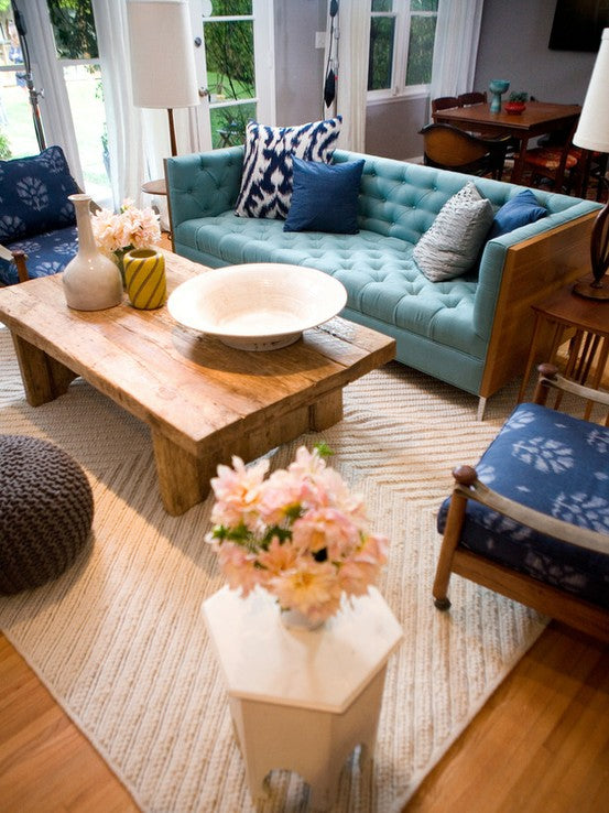 Teal and cream living room, with solid pieces of wooden furniture