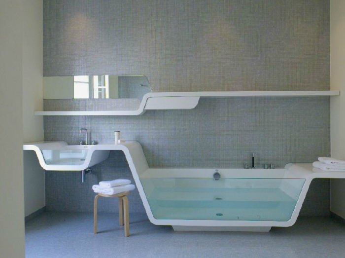 Sink and bathtub, each with one glass side