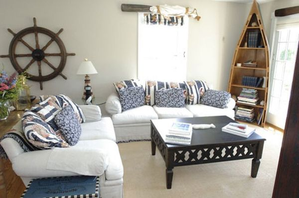 Coastal themed interior design with white sofas and blue and white striped cushions