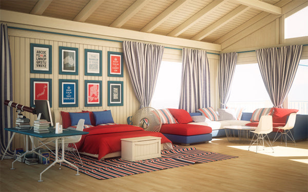 Large beach house with cream panel walls and ceiling, with red and blue furniture