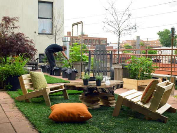 Rooftop garden with unlevel wooden chairs and tree trunk table top