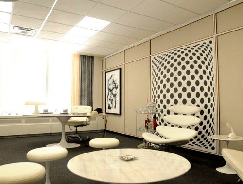 Mad Men style office, in white with funky chairs and desks