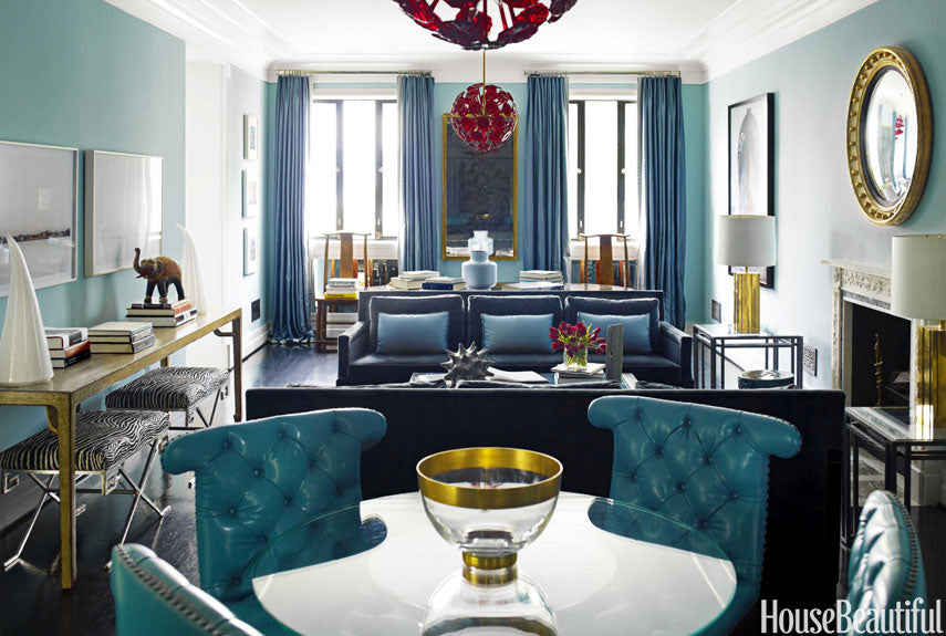 Teal living room, with dark blue furniture and hints of gold throughout