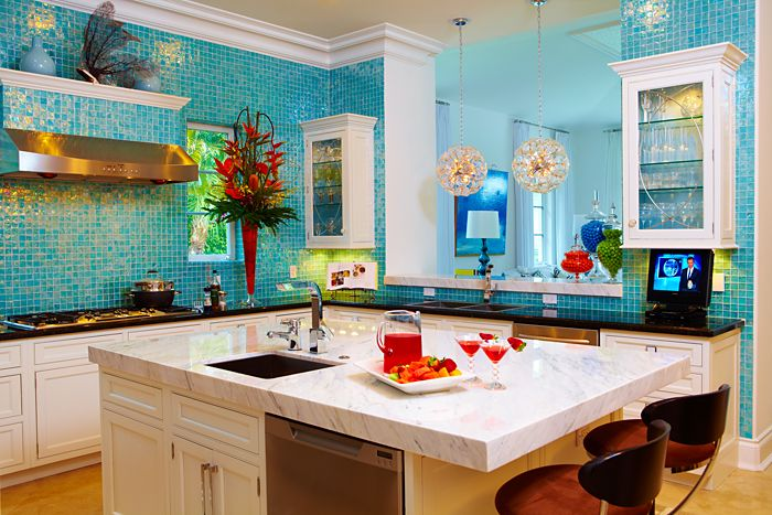 Kitchen with aqua blue small square tiles and cream kitchen units