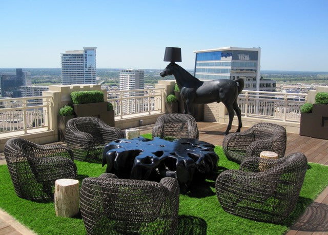 Modern roof top wicker seating area on artificial grass