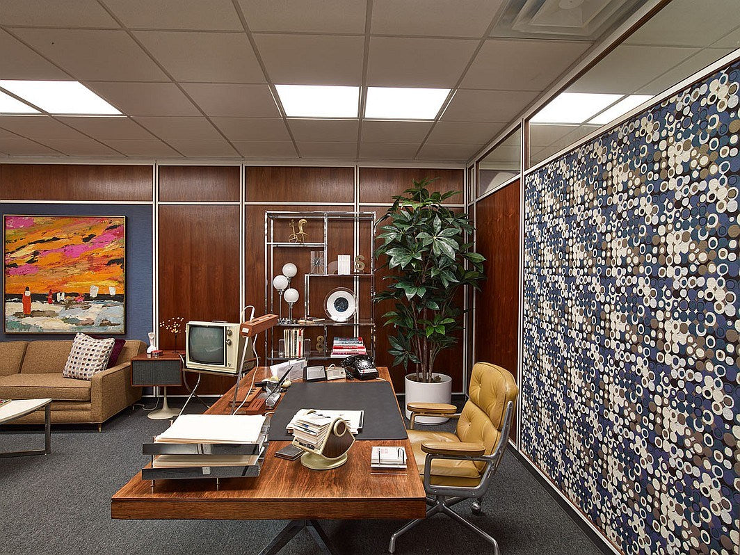 Sixties style office, with wooden walls and funky wall art