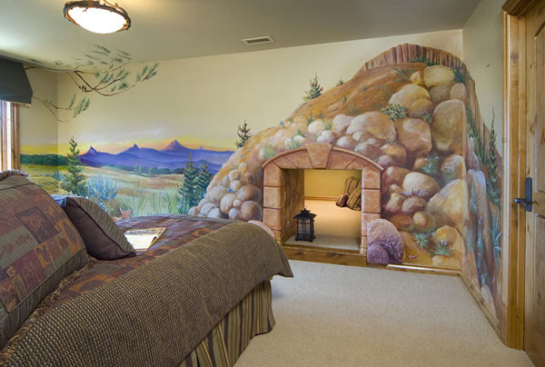 Hidden bedroom in a wall hideaway, with cave wall art