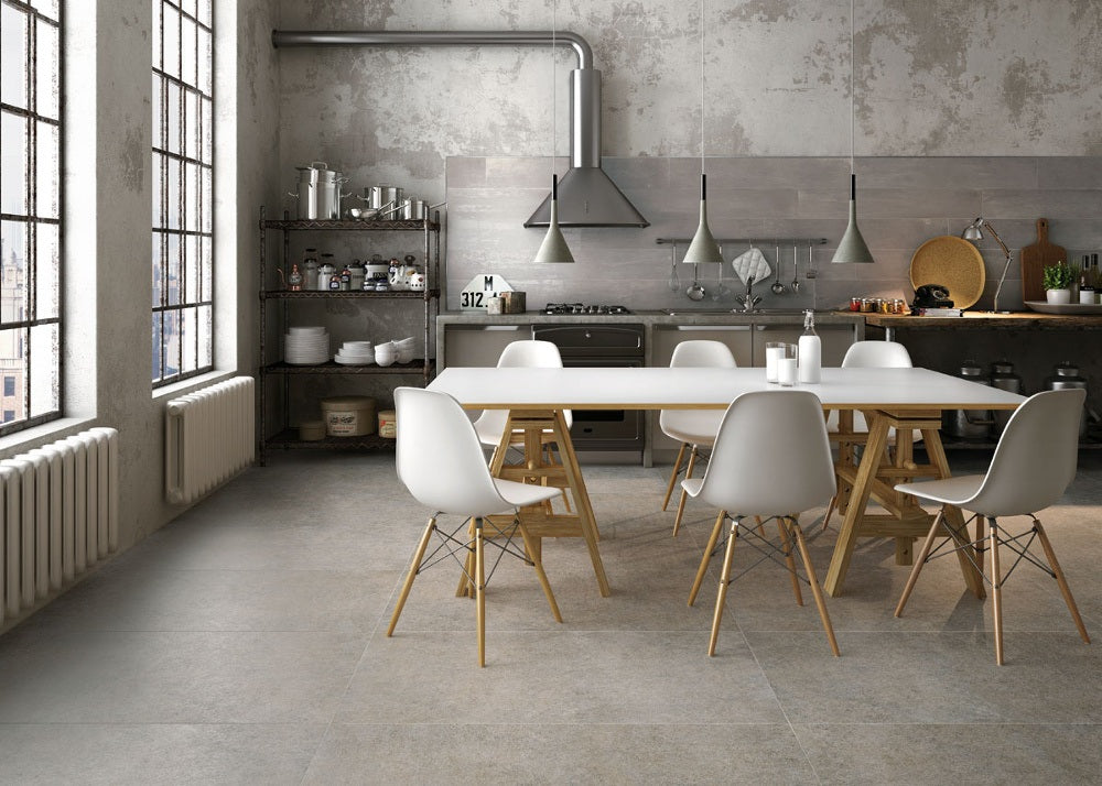 Industrial style kitchen and dining room with natural grey floor tiles