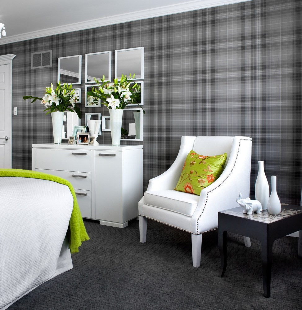 Grey checked wallpaper in a grey and white bedroom with touches of green throughout