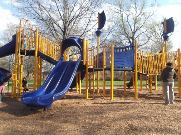 Large blue and yellow park climbing frame with two slides