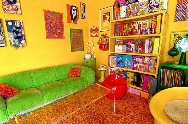 Yellow sixties style living room with bright green sofa