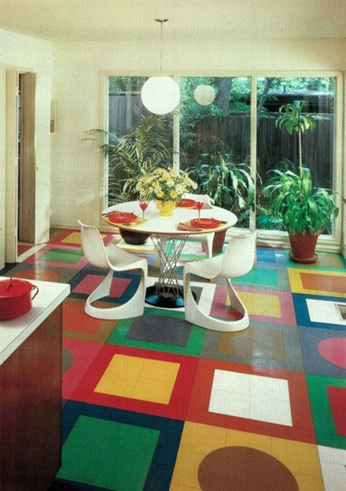 Dated sixties dining room with bright different coloured square floor tiles