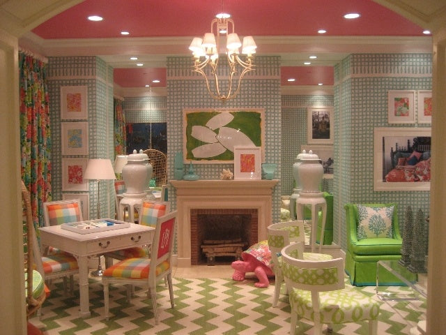 Cosy cottage dining room in pink and light blue, looks like you're looking inside a dolls house