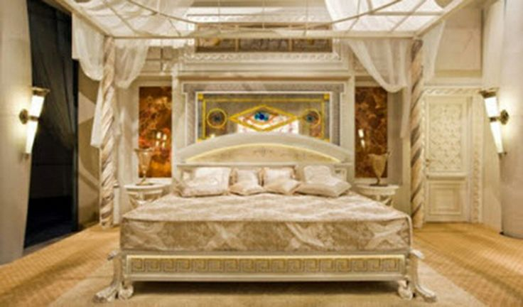 Cream and gold bedroom with a four poster bed