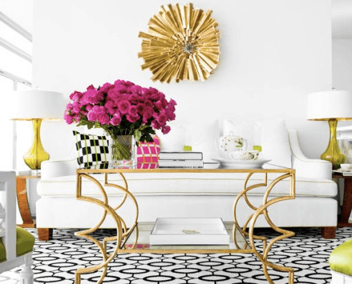 White and black living room, with white sofa, and touched of gold and pink