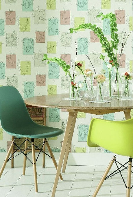 Light green dining room with herb and plant wallpaper and plants on the round dining room table