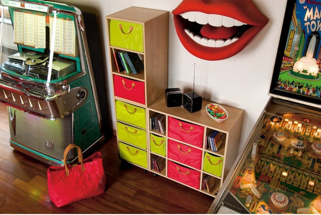 Juke box, pinball machine and set of shelves with green and pink drawers