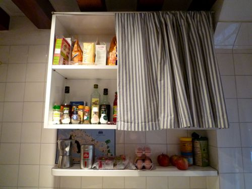 Floating shelves with curtain in front to hide away contents
