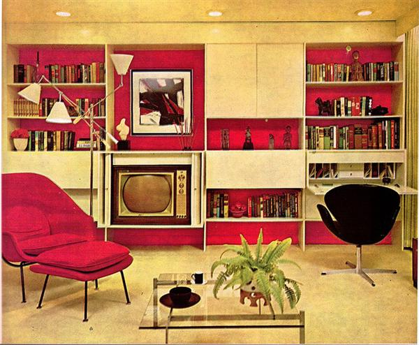 Vintage cream and pink living room with period sixties chairs, TV and cream fitted shelves